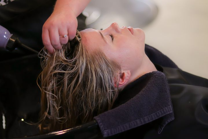woman getting a hair treatment in a salon