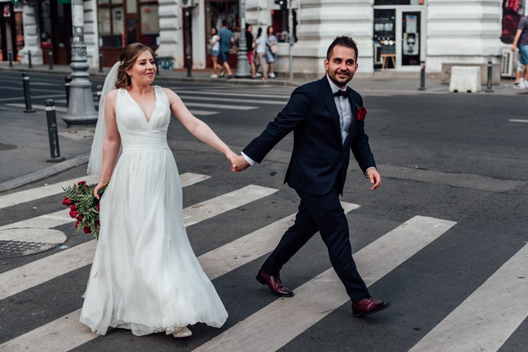bride and groom posing on a crossroad for prenup photos